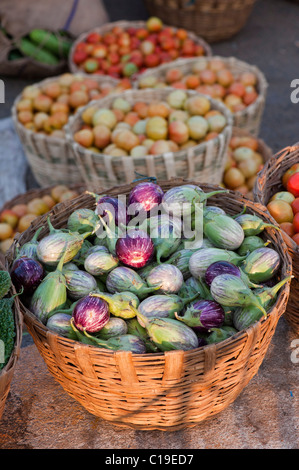 Aubergines / Eggplant , Tomatoes in baskets at an Indian market. Andhra Pradesh, India - Stock Photo
