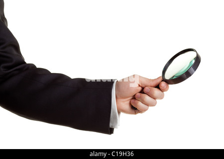 Hand holding a magnifying glass isolated on white. - Stock Photo