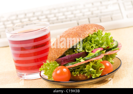 Lunch of sandwich with vegetables and juice - Stock Photo