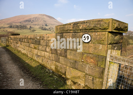 Bridge number fifty nine on the Sheffield to Manchester train line in Edale with Grindslow Knoll on Kinder Scout - Stock Photo