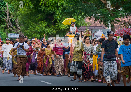A Balinese Hindu cremation ceremony taking place in the village of Pemuteran is a joyful occasion releasing the - Stock Photo