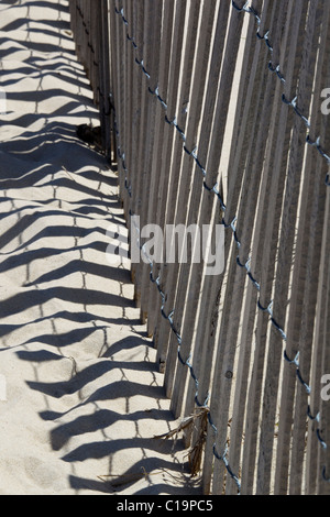 Design of strip pattern of a wind erosion control fence on beach in the sand - Stock Photo