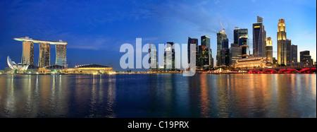 Singapore Skyline from Marina Bay Esplanade at Night Panorama - Stock Photo