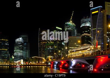 Singapore Skyline from Marina Bay Esplanade at Night - Stock Photo