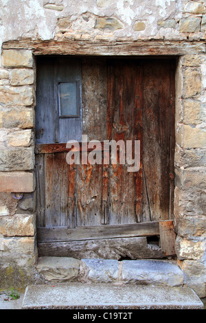 aged wood doors weathered vintage architecture detail - Stock Photo