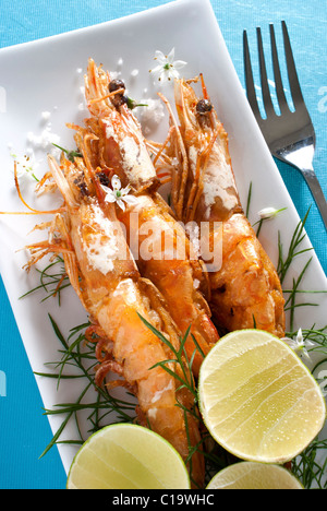 Grilled Prawns on a Long White Platter - Stock Photo