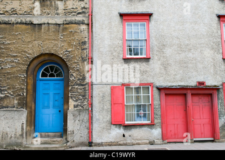 Red and Blue Painted Front Doors and Windows on Houses in Oxford - Stock Photo
