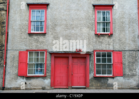 Red Painted Front Door and Windows on Terraced Houses in Oxford, UK - Stock Photo
