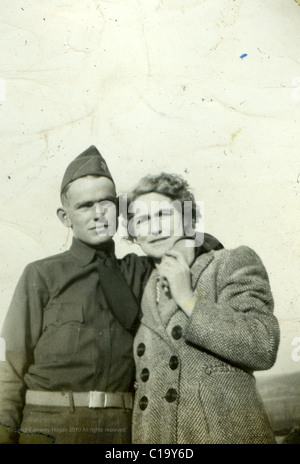 Photobooth portrait of mother and son in the mid 1940s WWII era Indiana Marines marine veteran fashion uniform - Stock Photo