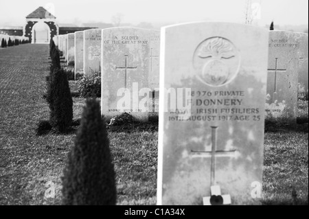 black and white moving image of war graves at tyne cot cemetery in belgium - Stock Photo