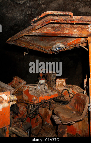 Abandoned mining equipment in a mine - Stock Photo