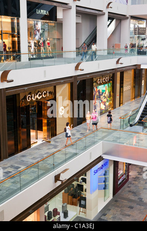 The Shoppes at Marina Bay Sands - a shopping mall in the  Marina Bay Sands hotel & casino complex, Singapore - Stock Photo