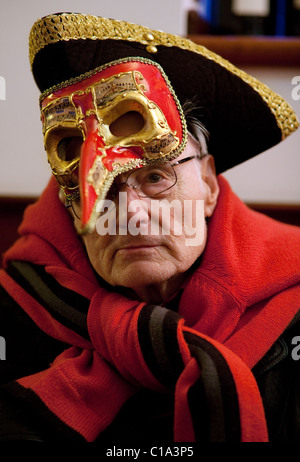 An elderly man in carnival costume and mask, the Venice carnival, Venice, Italy - Stock Photo