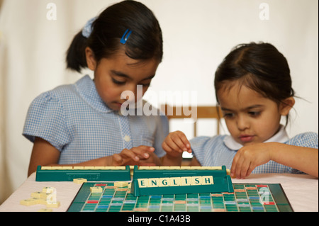 Kids playing scrabble game - Stock Photo