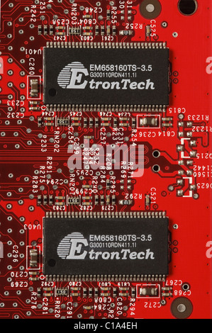 Twin Etron Tech DDR Synchronous DRAM - or SDRAM - on the printec circuit board of a Gainward graphics card - Stock Photo