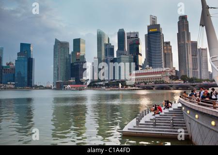 View of the city skyline from the Marina Bay esplanade.  Marina Bay, Singapore - Stock Photo