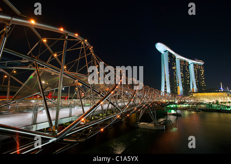 The Helix Bridge and Marina Bay Sands Singapore.  Marina Bay, Singapore - Stock Photo