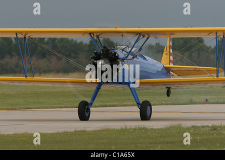 Boeing-Stearman Model 75 Kaydet, PT-13, WWII biplane primary trainer aircraft on takeoff roll, tail raised. - Stock Photo