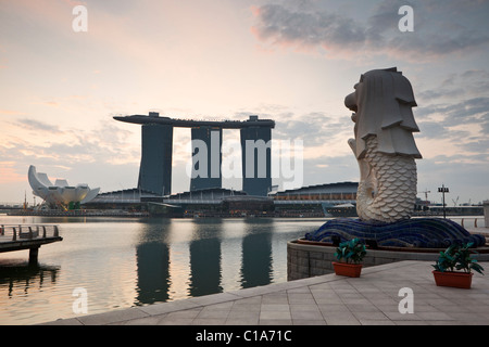 The Merlion Statue at dawn, with the Marina Bay Sands in the background.  Marina Bay, Singapore - Stock Photo