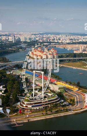 The Singapore Flyer and Formula One track on Marina Bay, Singapore - Stock Photo