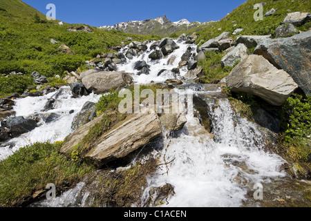 Mountain stream in the Alps - Stock Photo