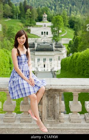 Woman at Linderhof Palace, Bavaria, Germany - Stock Photo
