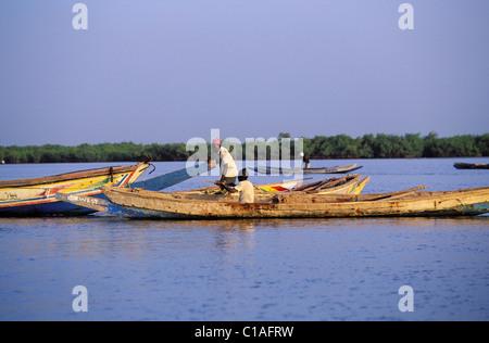 Senegal, Region of Sine Saloum, Fishermen on the river Saloum - Stock Photo