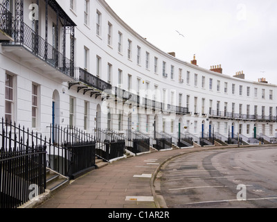 The Royal Crescent, a semicircle of Georgian townhouses in Cheltenham, Gloucestershire, England - Stock Photo