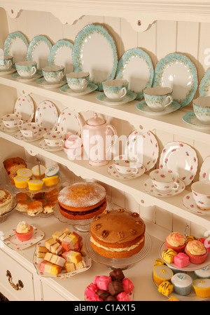 VINTAGE CHINA TEACUPS WITH CAKES - Stock Photo