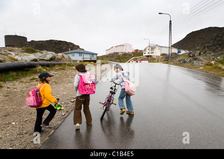 Girls going home from school. Qaqortoq (Julianehåb), South Greenland - Stock Photo