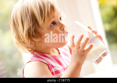 Child drinking glass of milk - Stock Photo