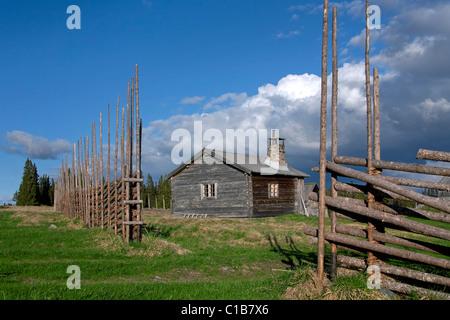 Wooden fence and log cabin of farm at Jaemtland / Jämtland, Sweden - Stock Photo