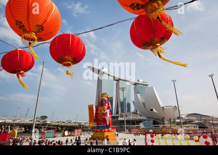 River Hongbao decorations (for Chinese New Year) and the Marina Bay Sands Hotel.  Marina Bay, Singapore - Stock Photo