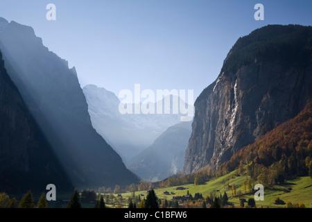 Morning light spills into the idyllic Lauterbrunnen Valley, Berner Oberland, Switzerland - Stock Photo