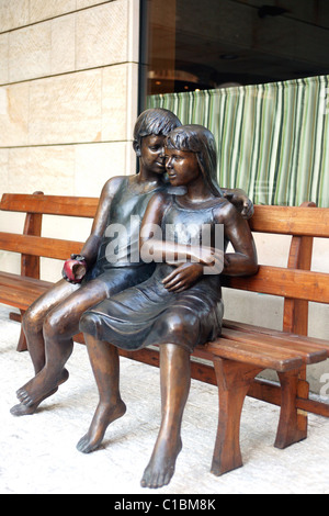 Czech Republic, Prague, Four Seasons Hotel, statue of a couple of teenagers in front of the hotel - Stock Photo