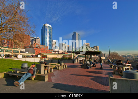 People Enjoy Sunny Winter Afternoon At Victor Steinbrueck Park Near Pike Place Market Seattle Washington USA - Stock Photo