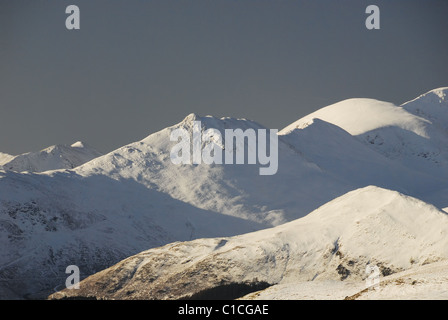 Snow covered Causey Pike in winter sunlight in the English Lake District - Stock Photo