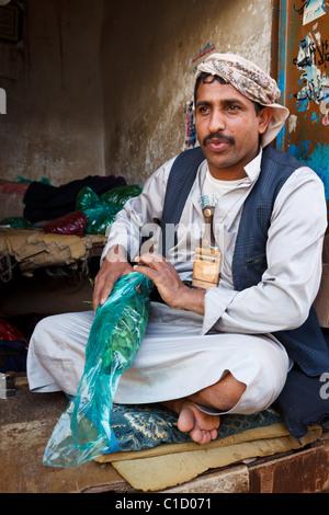 Man selling qat in market, Sana'a, Yemen - Stock Photo