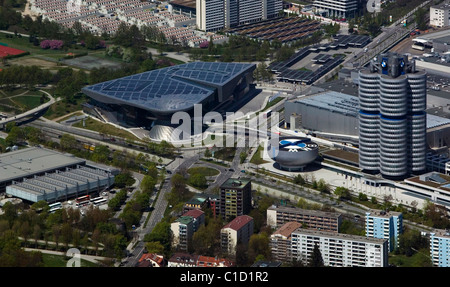 aerial view above BMW world corporate headquarters including the four cylinder tower and BMW Lifestyle Shop Munich - Stock Photo