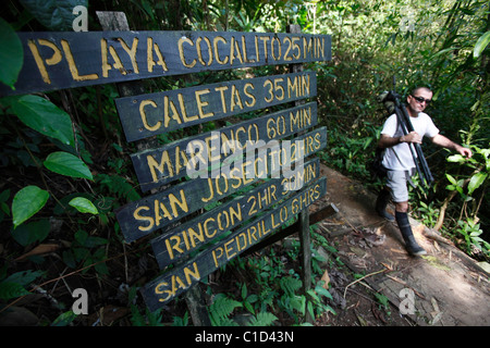 A man with a bird scope walking on the trail near Drake Bay, Osa Peninsula, Costa Rica - Stock Photo