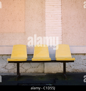 Three seats in a station - Stock Photo