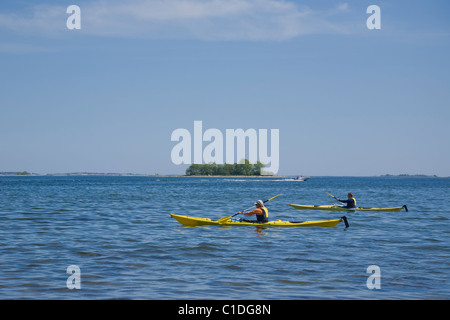 Two kayaks in the archipelago of Stockholm, Sweden. - Stock Photo