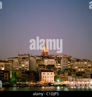 A twilight view across the Golden Horn to Karakoy and the Galata Tower Istanbul in Turkey in Middle East Asia. Landscape - Stock Photo