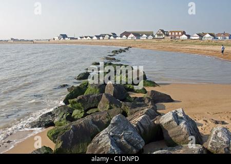 Rock armor protecting Jaywick Sands, Essex, England. - Stock Photo