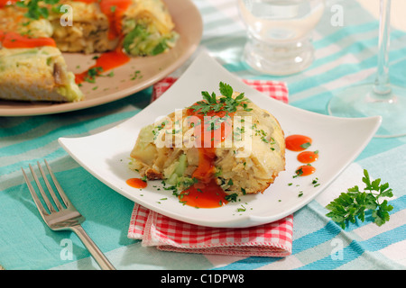 Potatoes omelet with fresh garlics. Recipe available. - Stock Photo