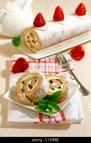 Meringue filled Swiss roll with strawberries. Recipe available. - Stock Photo