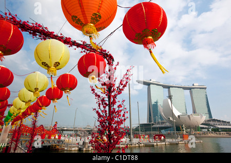 The Marina Bay Sands Singapore and Chinese New Year decorations on the waterfront.  Marina Bay, Singapore - Stock Photo