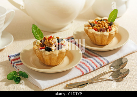 Tartlets with cheese and nuts. Recipe available. - Stock Photo