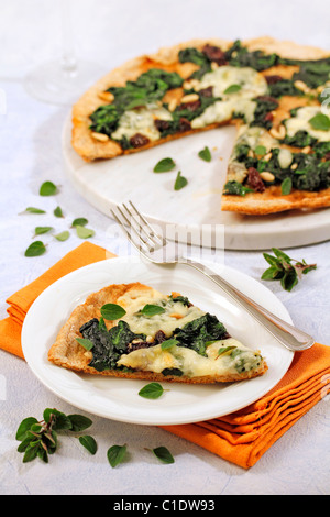 Wholemeal pizza with spinach. Recipe available. - Stock Photo