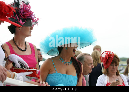 Women in hats at a horse race, Epsom, United Kingdom - Stock Photo